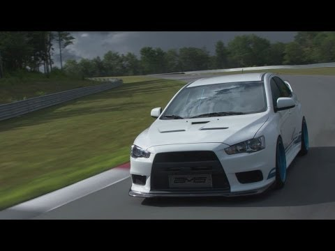 Tuned - The Mitsubishi Evo X is a great performer for the enthusiast on a budget, thanks to its very smart drivetrain. On top of that drivetrain sits an utterly terr...