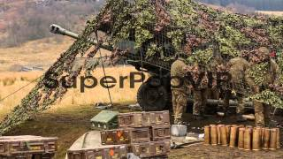 Otterburn United Kingdom  city pictures gallery : Royal Artillery gunners fire their 105mm light guns durin...