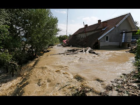 Footage - Two people died and several hundreds were forced to evacuate as surging floodwaters submerged villages in Romania on Tuesday. Footage filmed in Arges County on Wednesday showed emergency workers...