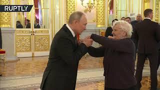 Putin meets his first teacher in Kremlin