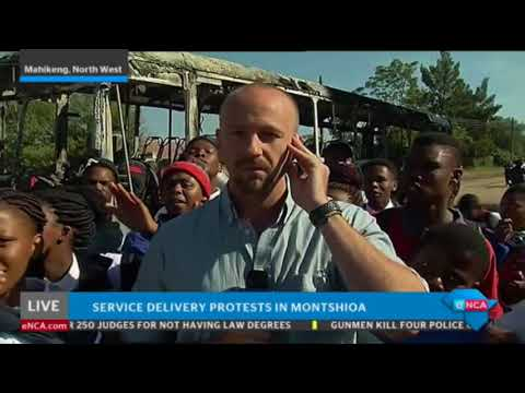 Protesters surround eNCA reporter on live TV