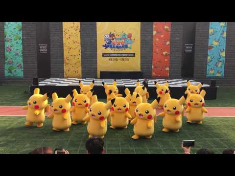 Men In Suits Rush Rapidly Deflating Pikachu To Safety
