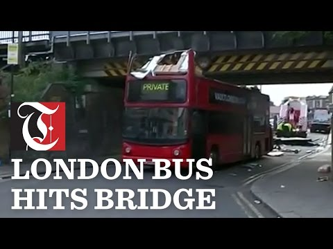 Double-decker bus hits bridge in London