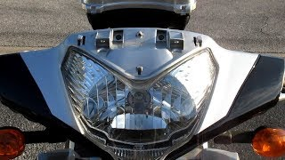 10. Kymco People GT 300i headlight bulb replacement (H4, 12V, 60/55W)