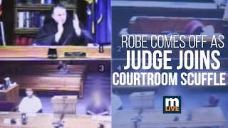 Video as Judge John McBain joins a courtroom scuffle. Read the MLive article: http://s.mlive.com/yxiHS8c.