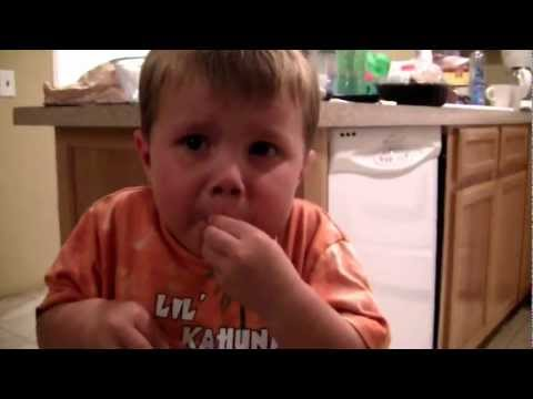 Adorable 3 year old kid eating super sour candy!