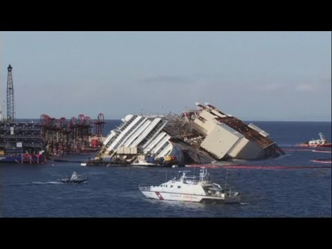 cruise ship Italy - A time lapse of the salvage operation to pull the wrecked Costa Concordia ship from the rocks off Giglio, Italy. Salvage crews on the Italian island of Gigli...