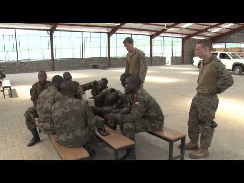 Marines are training Uganda Peoples Defense Forces Soldiers in support of the African Union Mission in Somalia. Petty Officer Cody Boyd takes us to the Singo Training Site in Uganda where these two forces are working together.