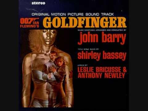 Tekst piosenki John Barry - Oddjob's Pressing Engagement po polsku
