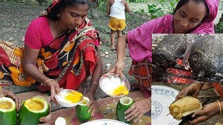 Amazing rural village recipe for eggs. Eggs omelette cooking in papaya hole like wild survival style. Here we used 12 pieces of eggs in two papaya hole with all types of masala. Then fire it in open place about 50 minutes and then serve the eggs to village 12-15 children. Please subscribe to get regular video update.