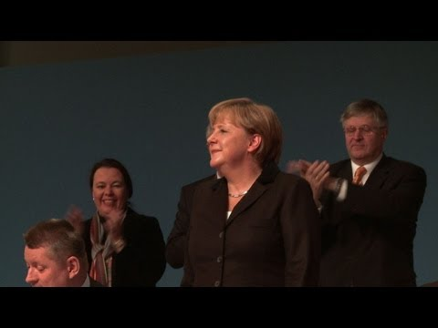 Merkel begins battle for third term in office