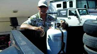 This is an innovative new tie-down strap for securing propane tanks in the back of a pickup truck and designed by a full-time RVer