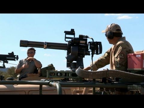 The minigun - Wil Willis compares the M2 and M134 in their medium range accuracy. | For more TRIGGERS, visit http://military.discovery.com/#mkcpgn=ytmil1 Subscribe to Mili...