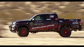 """Taking on Nevada's Mint 400, America's toughest, most storied off-road race, is hard enough in a purpose-built race truck. But attempting the gruelling desert course in a near-stock Toyota Tacoma TRD Pro? That's crazy talk… Huntington Beach, Calif.-based Camburg Racing dared to take on the challenge. It's a major player in off-road suspension systems and designs and builds its own race trucks, too – but competing with a near-stock vehicle offers a whole different set of challenges. Was the Tacoma TRD Pro bad-ass enough to take the beating? Follow """"Dealer to Desert"""" to find out."""