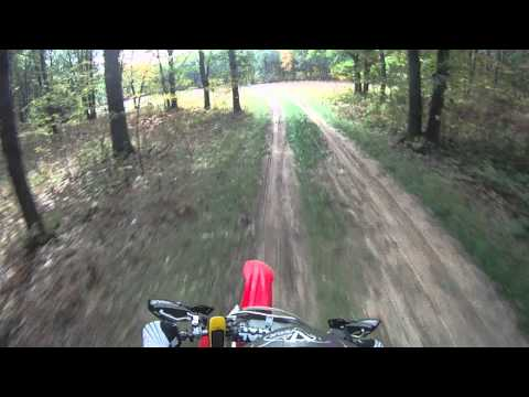 crf250r - 2006 Honda CRF250R & 2007 Yamaha YZ250F trail riding @my cabin in northern Michigan. My camera is on my cousins helmet via the suction cup mount. We took our...