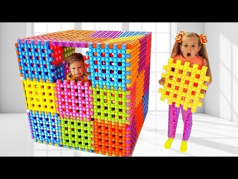 Diana and Roma Playing with Toy Blocks