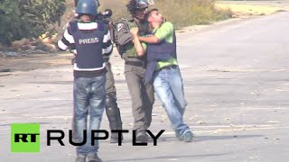 Ramallah Palestinian  city pictures gallery : Israeli police run over Palestinian protester, manhandle reporter in Ramallah