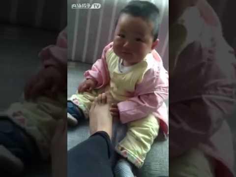 Baby smelling stinky feet