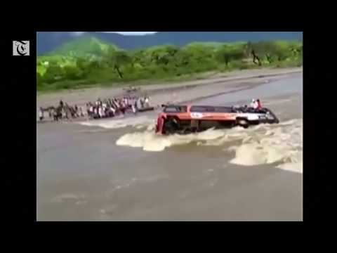 This bus was dragged into the swollen Rio Seco by strong currents.
