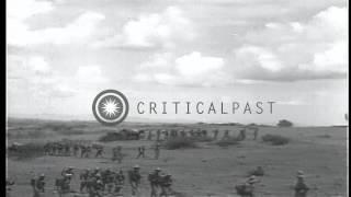Second Italian-Ethiopian War. Ethiopian Civilians Gather In A Field Near A Villag...HD Stock Footage