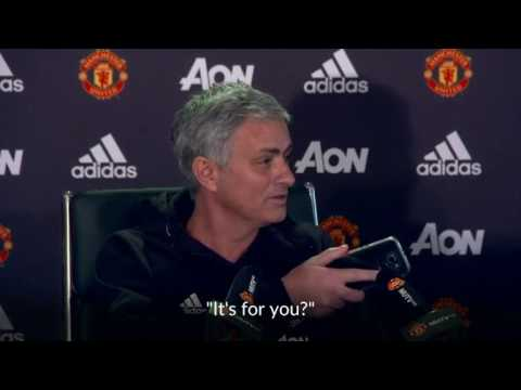 Manchester United manager Jose Mourinho picks up a journalist's phone during a news conference on Friday.
