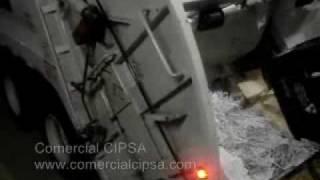 Rear loading compactors