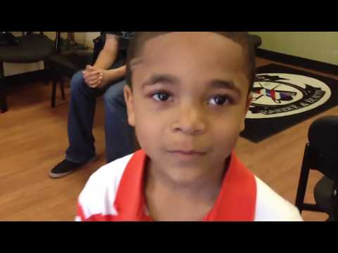 backflip - Elijah beats Zan jack in BACK FLIP contest at Dj Taber's barber & Beauty.