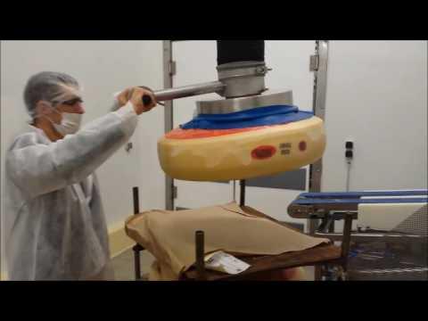 Manutention de meule de fromage