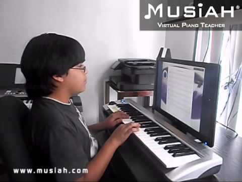 Piano Video: Piano Lesson #21 Pop Goes The Weasel played by Oscar