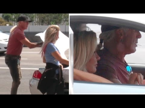 Twisted Sister's Dee Snider And Wife Suzette Hop Into Their BMW At LAX