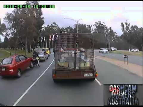 Lights - https://www.facebook.com/DashCamOwnersAustralia - A Motorbike waiting at a green light gets rear ended by a driver not paying attention nearly getting run over by a trailer in the next lane....