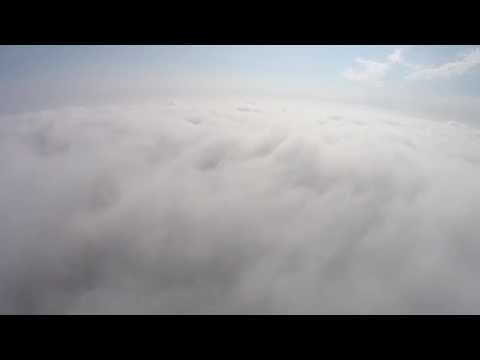 Dronie over the clouds. Selfie+Drone=Dronie