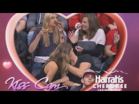Woman Stuffs Her Face With Pizza During Couple's Kiss Cam