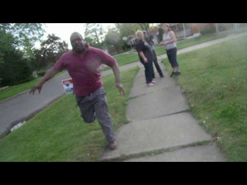 Crazy Neighbor And Dog Attack People 810 Flint Michigan:  2010_05_05 - Part 2  http://ascendents.net/?v=r7OUAWYkJFs  Part 3  http://www.ascendents.net/?v=RLy9QNcx36g  A peaceful street until he, and his dogs moved in around 2009.  They barked all day pissing off neighbors.  Animal Control no longer works the field, instead, it is basically a phone number.  If you call them regarding a barking dog, they instruct you to call 911.  Why should emergency services be used for dog situations?Early 2010 the kid and his friends were on his fort when they noticed smoke billowing out from Larry's place.  The kid knocks on Larry's door.  It took about 2 minutes for Larry to answer.  When he did, he told the kid that he was burning papers in the basement.  It was a friendly encounter.  Someone called the fire department and a full size fire truck arrived which probably annoyed Larry and naturally he would suspect the kid called them.  Some weeks later, the kid walks to Larry's house to complain about his barking dogs.  Larry answered the door and kinda stepped out.