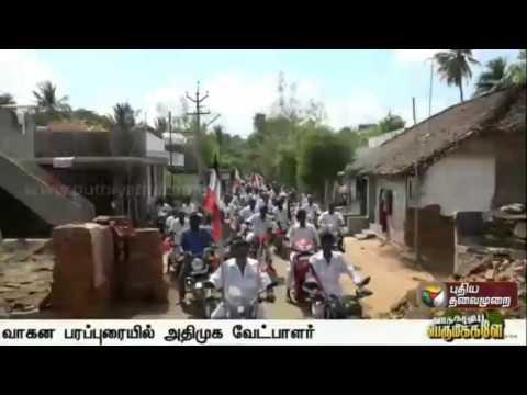Mayiladuthurai-ADMK-candidate-Radhakrishnan-campaigning-atop-an-open-vehicle