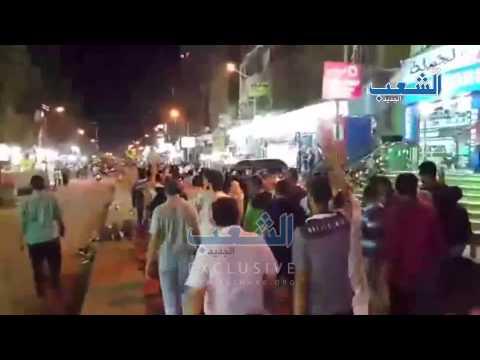 مسيرة ليلية بالمهندسين في ذكرى مذبحة الساجدين