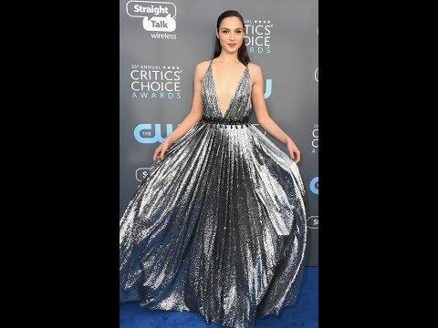 Wonder Woman Gal Gadot unloads perky assets in dress slashed to navel
