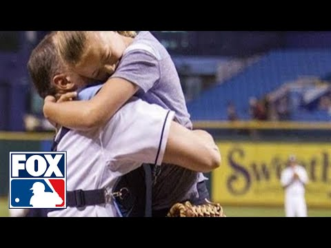 military - 9 year old Alayna Adams threw out the first pitch before Thursday's Tampa Bay Rays-Boston Red Sox game, only to be surprised that the man in the catcher's ma...