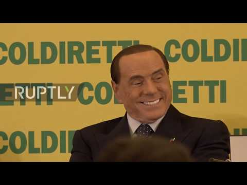 Italy: Berlusconi touts low taxes as he feasts on cheese at farmers' meeting