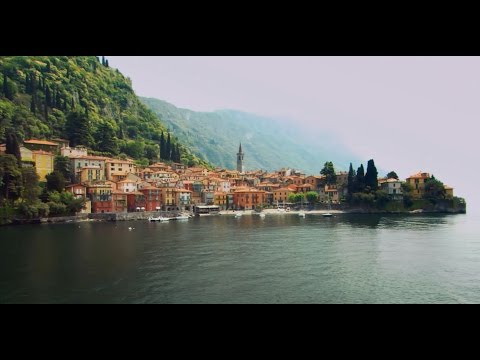 lake - Lake Como  lined with palm trees and elegant pastel-colored villas, crowned by snowcapped mountains, and criss-crossed by a fleet of ferries and hydrofoils ...