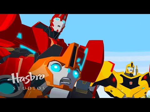 robots in disguise - Watch the EXCLUSIVE Comic-Con premiered first look at the newest Transformers series from Hasbro Studios!