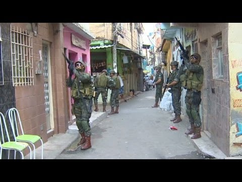 Army - Brazil has stepped up efforts to secure its notorious slums ahead of the World Cup. CNN's Shasta Darlington reports. More from CNN at http://www.cnn.com/ To license this and other CNN/HLN...