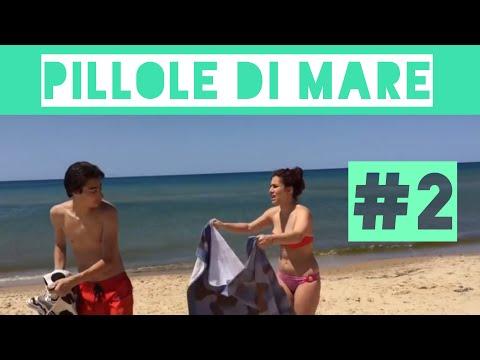 coppia di fidanzati in spiaggia - problemi con il telo