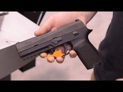 Video SHOT Show 2014: SIG P320 & SIG556XI download in MP3, 3GP, MP4, WEBM, AVI, FLV January 2017