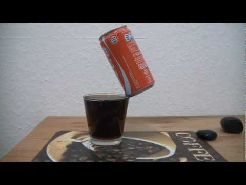 Coke Can balancing on edge of a glass
