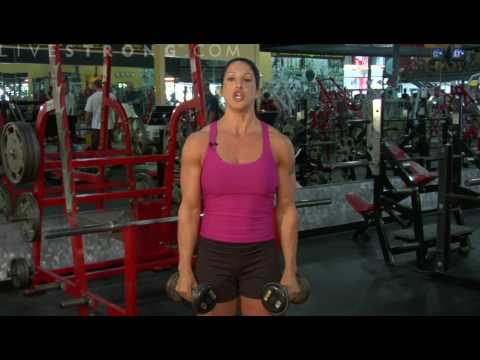 lateral raises - Increase arm strength with side dumbbell lateral raises. Learn how to work out with dumbbell exercises in this training video.