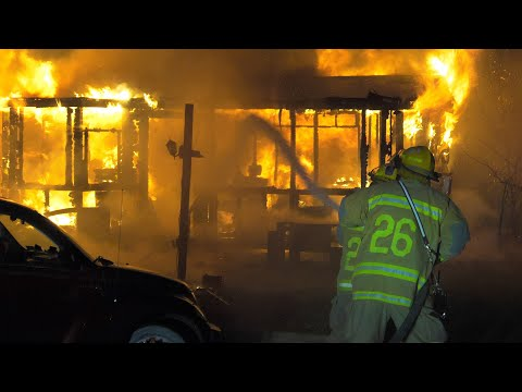 PRE-ARRIVAL: Firefighters arrive to find this trailer home fully-involved with 2nd home on fire
