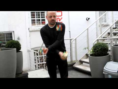 Guy Solves 3 Rubik's Cubes WHILE JUGGLING