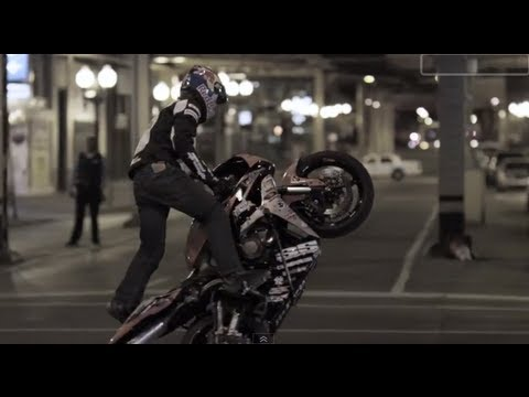 stunt - http://youtube.com/redbull To display his talents on a motorycle, Red Bull Athlete Aaron Colton, age 19, takes over the city streets of downtown Chicago. Fro...