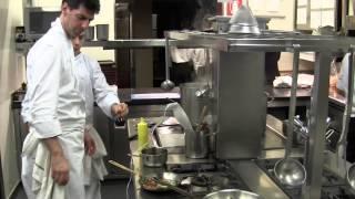 Alajmo cooks a main dish at his 3 Michelin Le Calandre